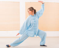 Woman doing qi gong tai chi exercise Stock Image