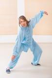 Woman doing qi gong tai chi exercise Stock Photos