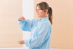 Woman doing qi gong tai chi exercise Stock Photography