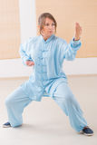 Woman doing qi gong tai chi exercise Royalty Free Stock Image