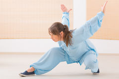 Woman doing qi gong tai chi exercise Stock Images