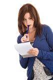 Woman doing records biting pen Royalty Free Stock Images
