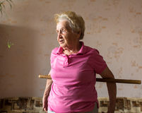 Woman doing rehab exercises with a stick at his home. Royalty Free Stock Images