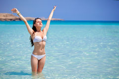 A woman is doing relaxation exercise. A beautiful woman is doing relaxation exercise royalty free stock image