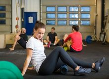Woman Doing Relaxation Exercise In Crossfit Gym Royalty Free Stock Image