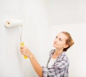 Woman doing repairs Royalty Free Stock Image