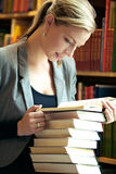 Woman doing research in library Royalty Free Stock Photography