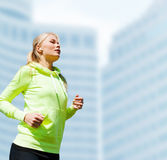 Woman doing running outdoors Stock Photography