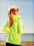 Woman doing running outdoors Royalty Free Stock Image