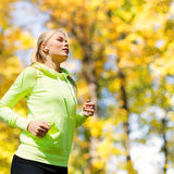 Woman doing running outdoors Royalty Free Stock Photo