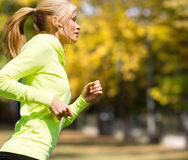 Woman doing running outdoors Stock Image