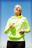 Woman doing running outdoors Royalty Free Stock Images