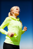 Woman doing running outdoors Royalty Free Stock Photography
