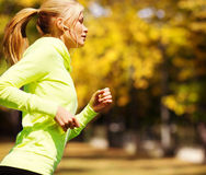 Woman doing running outdoors Stock Images