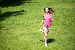 Woman doing running outdoors. Royalty Free Stock Photo