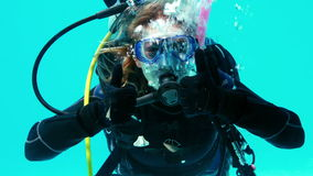 Woman doing scuba training in swimming pool stock footage