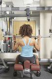Woman doing seated exercises at the gym Stock Photo