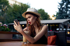 Woman doing selfie in a cafe on the terrace Royalty Free Stock Photography
