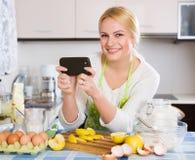 Woman doing selfie at kitchen Stock Photos