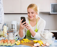 Woman doing selfie at kitchen Royalty Free Stock Photos