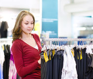 Woman doing shopping and choosing clothes Stock Photo