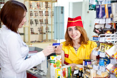 Woman doing shopping in a grocery store Stock Images