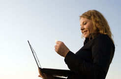 Woman doing shopping in a internet on laptop Royalty Free Stock Images
