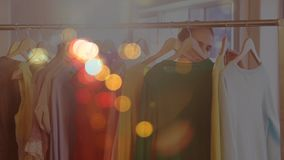 Woman doing shopping surrounded by colorful bokeh effect. Digital composite of young woman doing shopping surrounded by colorful bokeh effect stock footage