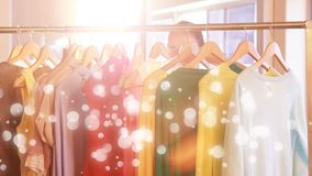 Woman doing shopping surrounded by white bubbles effect. Digital composite of young woman doing shopping surrounded by white bubbles effect stock video footage