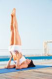 Woman doing a shoulder stand Stock Photo