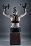 Woman doing shoulder workout Royalty Free Stock Images