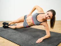 Woman doing side elbow plank Royalty Free Stock Photos