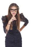 Woman doing silence sign Stock Photography