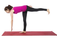 Woman doing single leg single arm reach for fitness Royalty Free Stock Photography