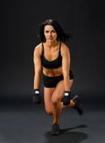 Woman doing single leg squatting Stock Images