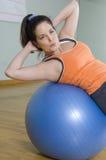 Woman Doing Sit-Ups Stock Photos