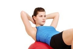 Woman doing sit ups on exercise ball Stock Images