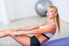 Woman doing sit-ups on the floor Stock Photo