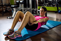 Woman doing sit-ups Stock Photos