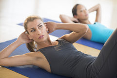 Woman Doing Sit-Ups At Gym Royalty Free Stock Photos