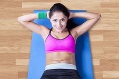 Woman doing sit ups on mattress Stock Image