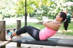 Woman doing sit ups on outdoor exercise park Royalty Free Stock Photography