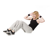 Woman doing situps. Towards white background Royalty Free Stock Photography