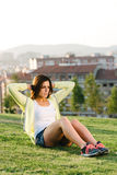 Woman doing situps exercise in city park. Sporty woman doing crunches workout in city park outdoor. Female beautiful athlete exercising Royalty Free Stock Photography