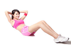 Woman doing situps in full length. Exercise woman doing situps workout training in full length isolated on white background. Asian sport fitness woman smiling Royalty Free Stock Images