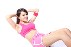 Woman doing situps workout training. Exercise woman doing situps workout training isolated on white background. Asian sport fitness woman smiling cheerful and Stock Photography
