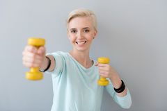 Woman doing some exercises with dumbbells Stock Photo