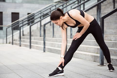 Woman doing some exercises outdoors Stock Image