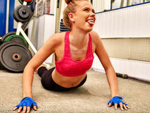 Woman doing some push ups in gym. Fun young woman doing some push ups in gym Royalty Free Stock Photo