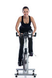 Woman doing spinning bike Stock Images